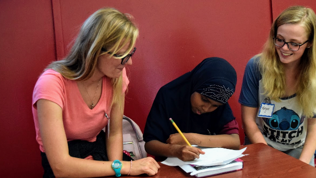Volunteers Tutoring Students at United Women of East Africa